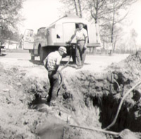 Early Jones employees doing tank installation.